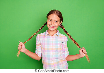 Close up photo small little age she her girl hold hand arm showing tails pigtails positive optimistic nice pretty wear casual checkered plaid shirt isolated green bright vibrant vivid background