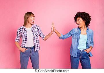 Close up photo two cheer diversity she her ladies different race skin hold clap arms amazed glad great company wear casual jeans denim checkered shirt clothes outfit isolated pink background