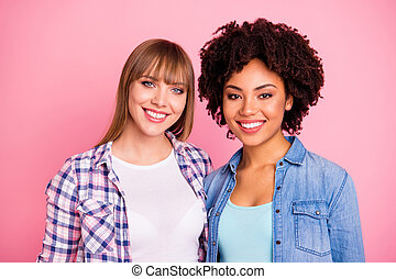 Close up photo two cheer diversity she her ladies different race skin toothy beaming smile love company each other wear casual jeans denim checkered shirt clothes outfit isolated pink background