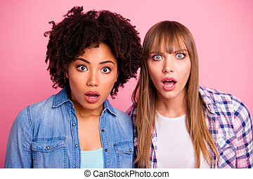 Close up photo two diversity she her ladies different race skin open mouth oh no awful situation not believe eyes wear casual jeans denim checkered shirt clothes outfit isolated pink background