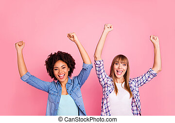 Close up photo two diversity she her ladies different race skin yell arms hands raised up unbelievable triumph lucky wear casual jeans denim checkered shirt clothes outfit isolated pink background