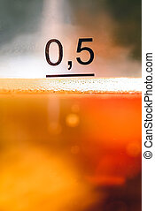 Close-up photo with half liter of beer