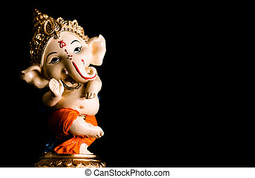 close up photography of beautiful ganesha statue standing on black background. religious concept