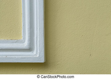 close up picture frame on the yellow wall.