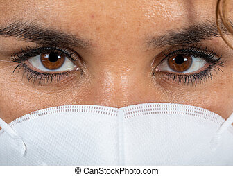 Close-up picture of an infected woman wearing a mouth mask
