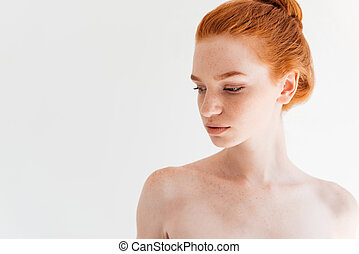 Close up picture of attractive ginger woman looking away