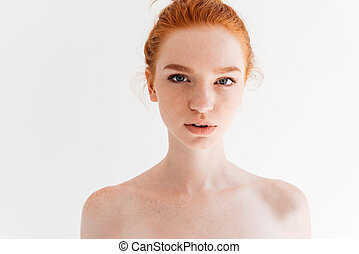 Close up picture of ginger woman looking at camera