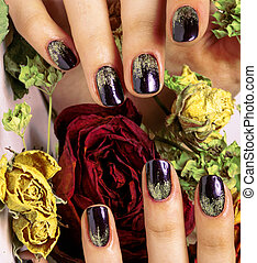 close up picture of manicure nails with dry flower red rose...