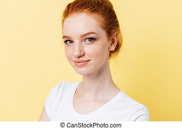 Close up picture of smiling girl looking at the camera