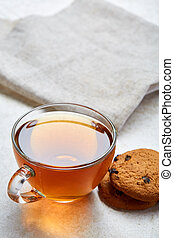 Close up picture of tea in glass cup with biscuit cookies ...