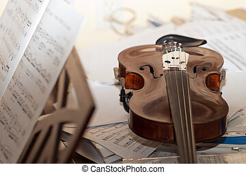 Close-up picture of the old  violin with score