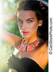 Close up picture of young sensual brunette wearing necklace