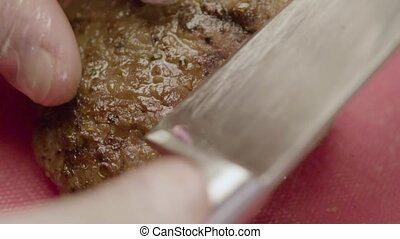 Roasted Hot Meat Steak Lies On A Pink Surface - Close-up -...