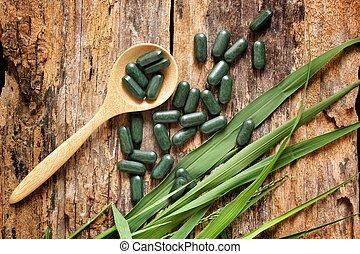 close-up pill wheat grass - chlorophyll pill