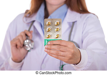 close up pills with female doctor