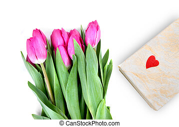 close-up pink tulips with gift isolated on white