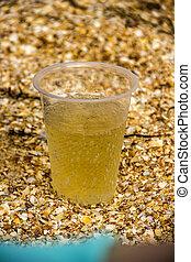 plastic glass of lemonade