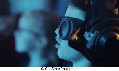 Close up portrait a boy in a pilot's helmet and glasses