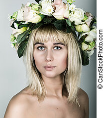 close-up portrait beautiful blonde girl with red lips, bare shoulders, and a wreath on his head