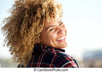 behind of happy african american woman with curly hair
