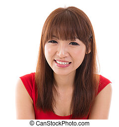Close up portrait headshot of Asian woman smiling wearing...