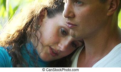 Close-up portrait hugging couple.