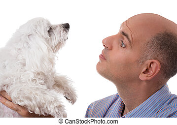 close up portrait in profile of man looking to maltese dog, isolated