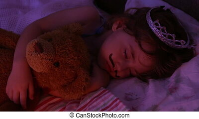 Close-up portrait little girl sleeping in bed. girl with a...
