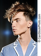 close-up portrait - Male hairstyle concept. Fashionable...