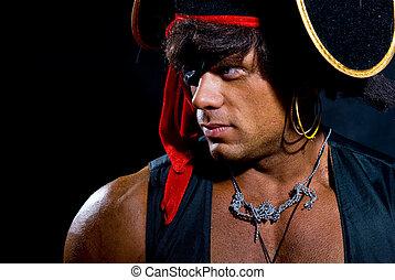 Close-up portrait muscular pirate in the studio on a dark backgr
