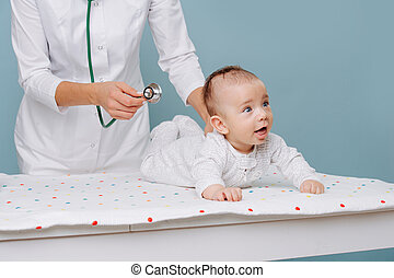 baby lying on the table, pediatrician doctor appointment