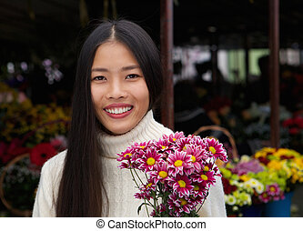 beautiful asian woman smiling with flowers
