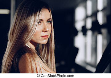 Close up portrait of a beautiful blonde woman with long hair smiling