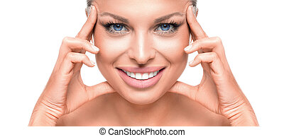 Close up portrait of a beautiful blue eyed woman toucnig her face. Isolated on white.
