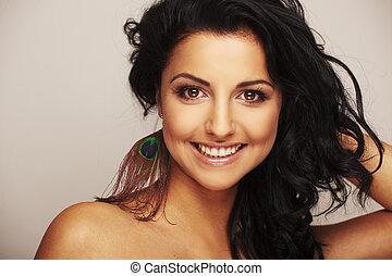 beautiful brunett model in studio on light background - ...