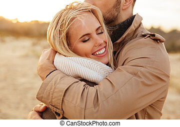 Close up portrait of a beautiful couple in love hugging