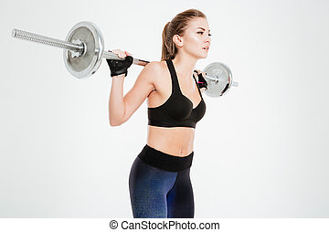 Close up portrait of a beautiful fitness woman with barbell...