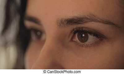 close-up portrait of a beautiful girl eye masters for the production of jewelry, works with blanks.