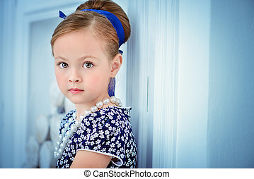 b3d93b52f740 Little girl with retro hairstyle. Cute little girl in red velvet ...