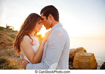 Close up portrait of a beautiful married couple at the beach