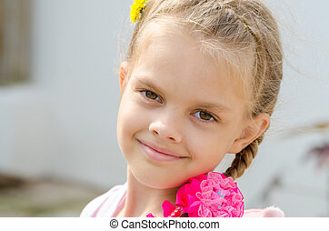Close-up portrait of a beautiful six year old girl