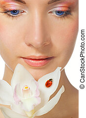 Close-up portrait of a beutiful girl with white orchid