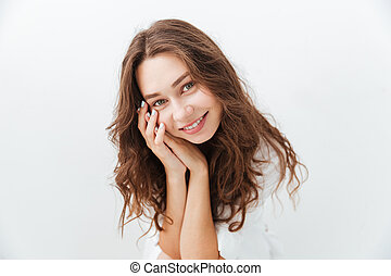 Close up portrait of a charming girl looking at camera