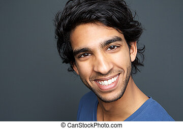 Close up portrait of a cheerful young man smiling