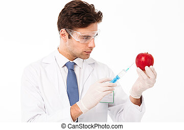 Close up portrait of a concentrated young male doctor