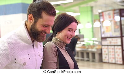 Close-up portrait of a couple in love in the supermarket.