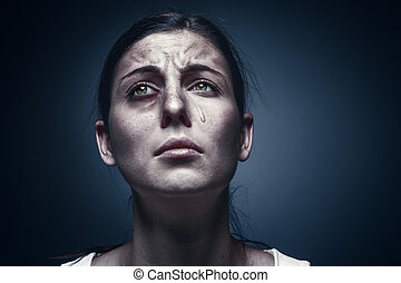 Close up portrait of a crying woman with bruised skin and black eyes