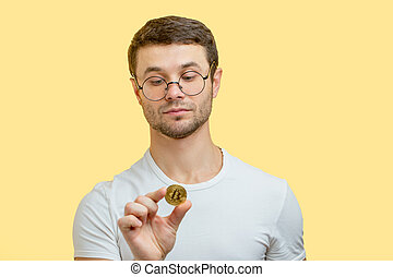 close up portrait of a cute collector who is checking the golden coin