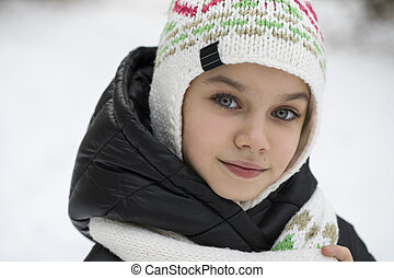 Close up portrait of a cute little girl in winter time
