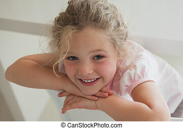 Close-up portrait of a cute smiling girl
